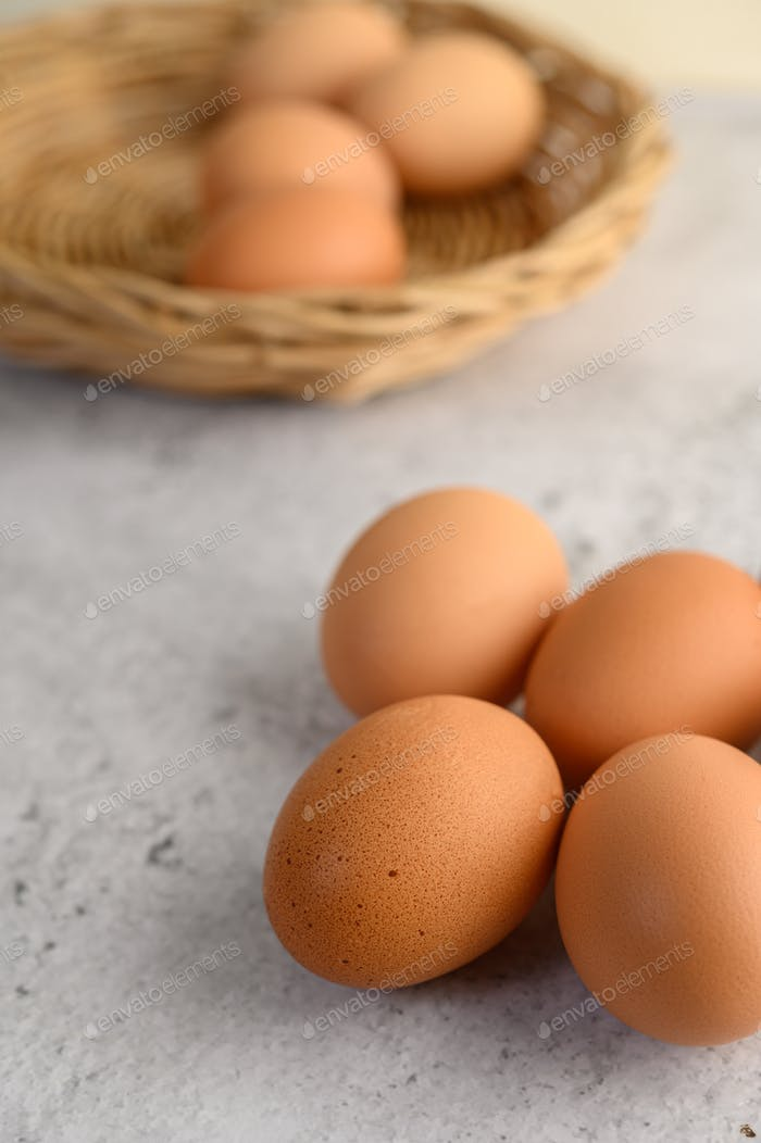 Organic brown eggs several on the floor