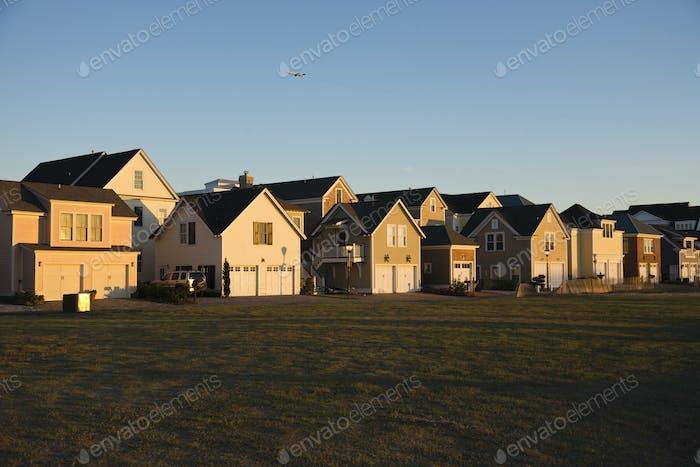 Duplexes Near Grassy Field