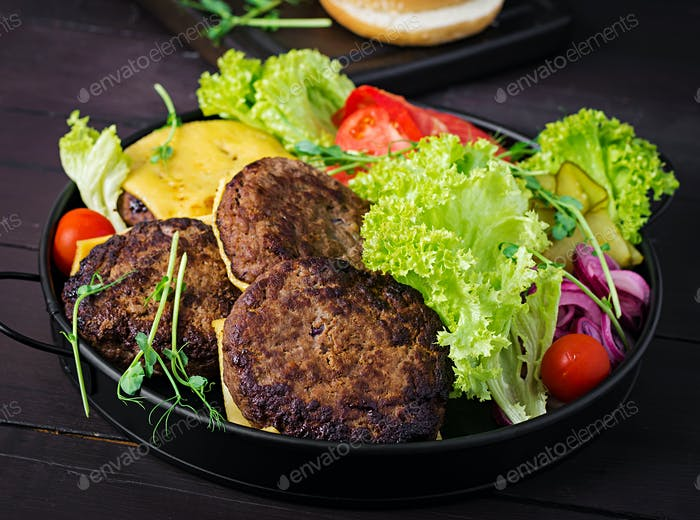 Burger cooking - burger with beef,  tomato, cheese, pickled cucumber and red onion on plate