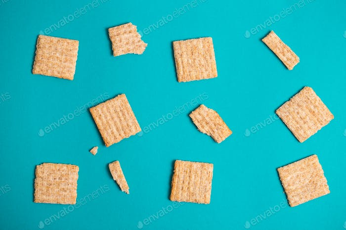 Dry cracker cookies blue background