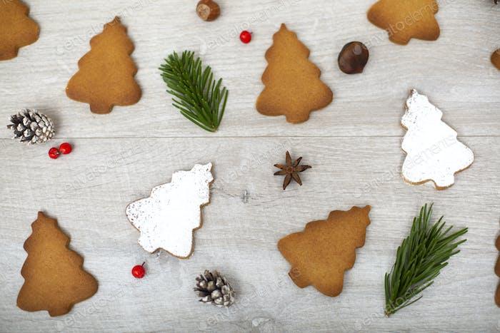High angle close up of Christmas decorations and Christmas Tree cookies.