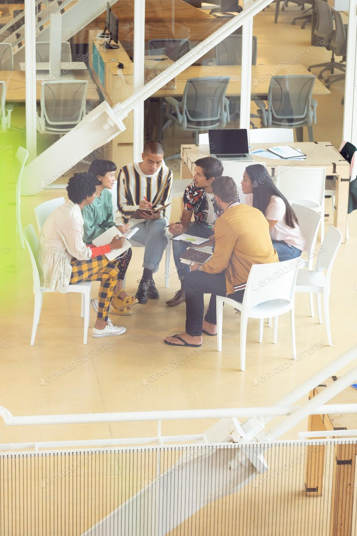High angle view of diverse Business people sitting together and having group discussion in office