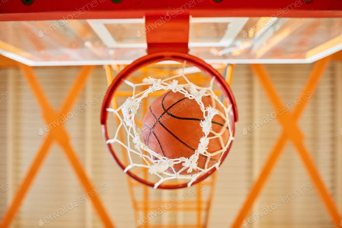 Ball falling through basketball basket