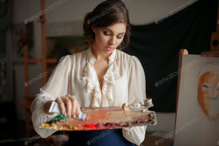 Female painter adds color to the palette in studio