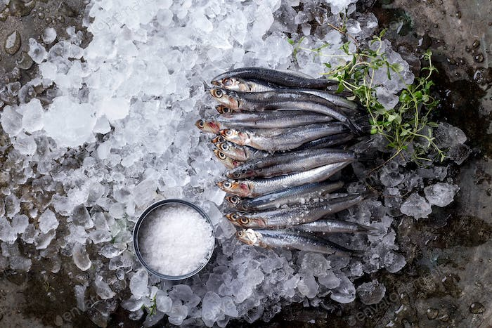 Raw anchovies with salt and lemon