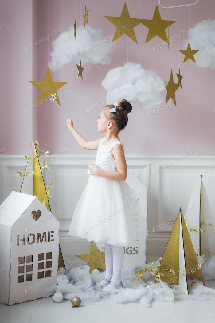 Little girl in fairy costume in fairy decoration