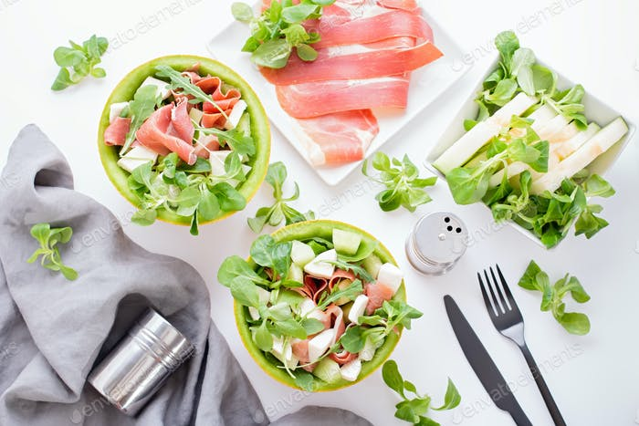 Summer mediterranean salad with ham and melon