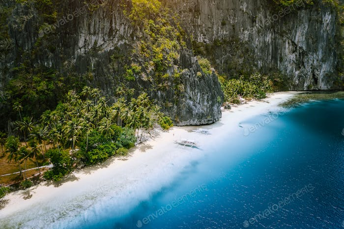 Aerial drone view of tropical exotic beach of Pinagbuyutan Island in El Nido. Amazing white sand