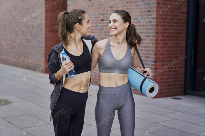 Bets friends in sports clothes going to training together