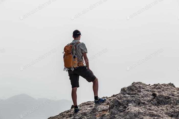 Man climbing hiking inspiration landscape, travel concept