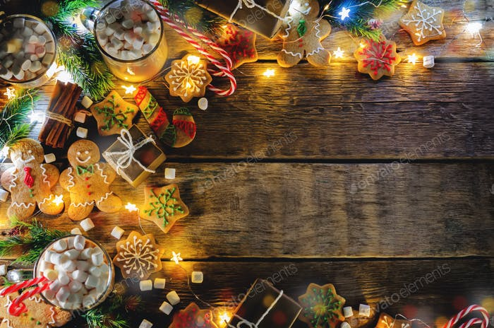 Dark wooden background with cocoa, gingerbread cookies, Christma