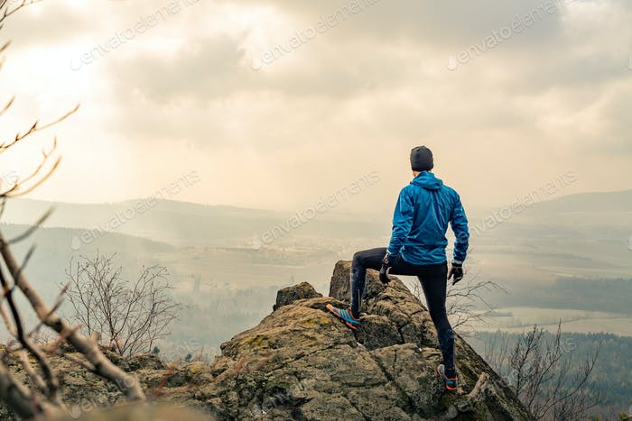 Man looking and celebrating sunrise and landscape