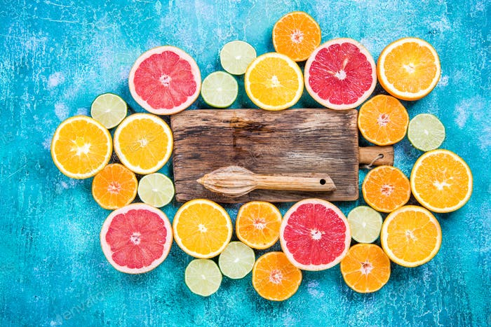 Halves of citrus fruits overhead, healthy eating