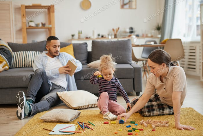 Modern Family Playing with Little Kid at Home