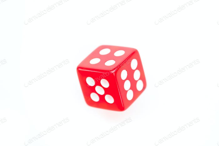 Red dice in motion against a white background