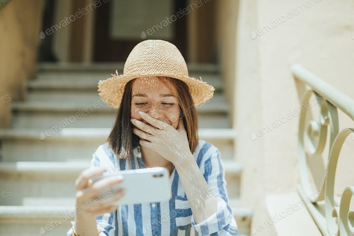 Woman watching an online movie on her phone