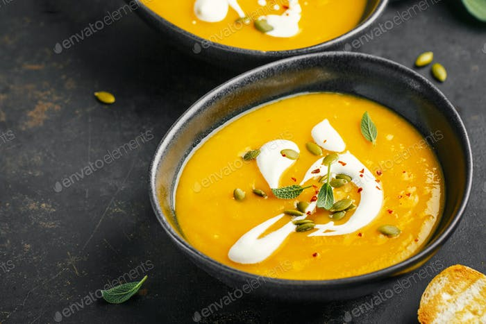 Pumpkin creamy soup served in bowls