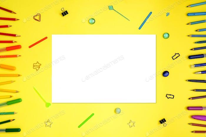 Stationery on yellow. Flat lay.
