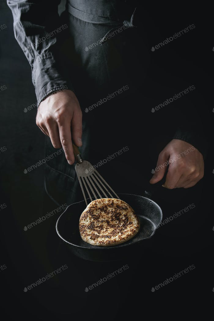 Chef cooking pancakes
