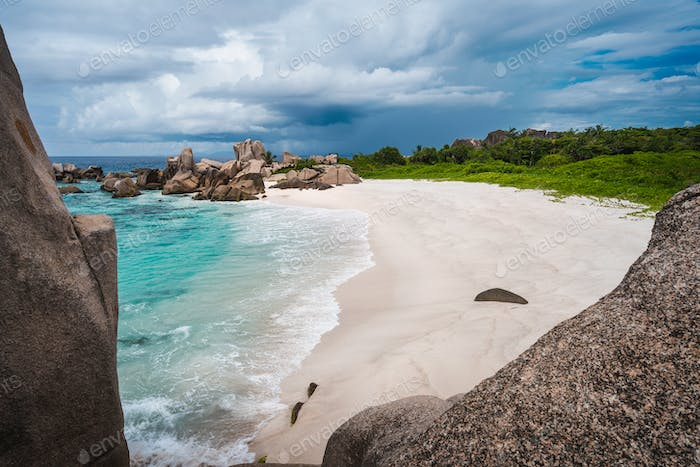 Tropical island landscape of secret beautiful beach, Anse Marron, La Digue, Seychelles