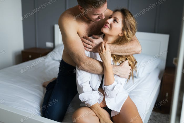 Thumbnail for Tenderness od a beautiful couple in bedroom