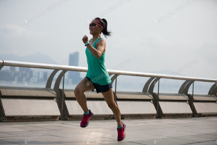 Sporty woman running in Hong Kong