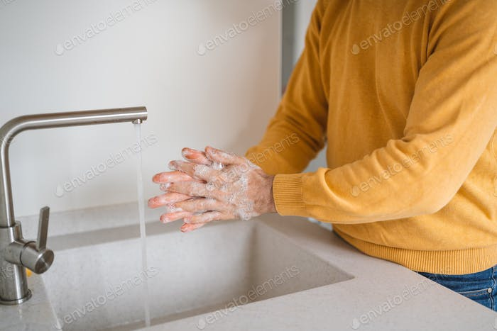 Coronavirus prevention. Man wash our hands with antibacterial soap