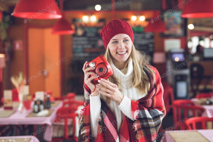 Happy attractive woman with a red polaroid