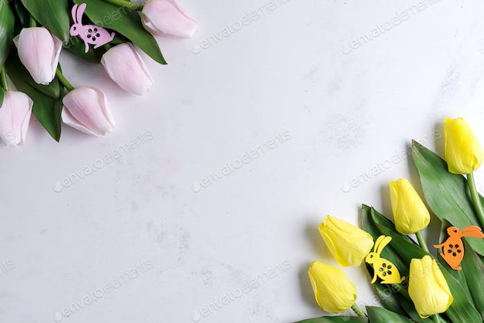 spring tulips with easter bunny on marble background with sample text