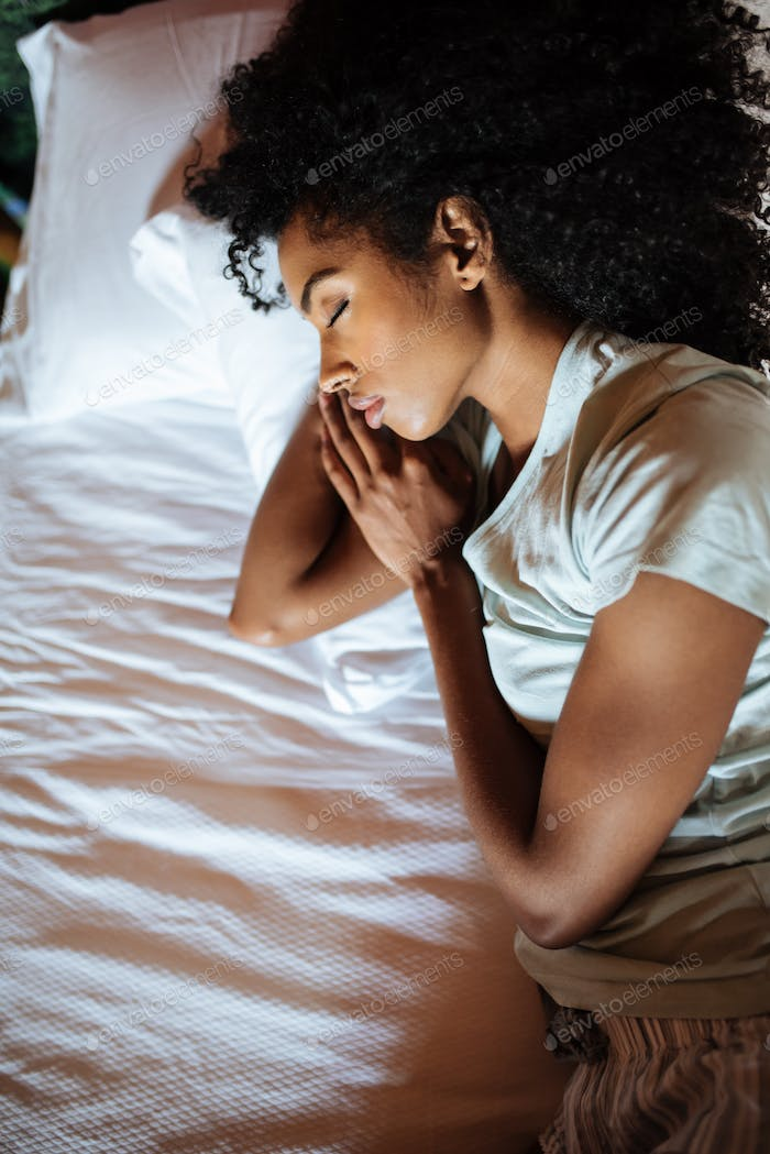 Beautiful black woman sleeping in bed