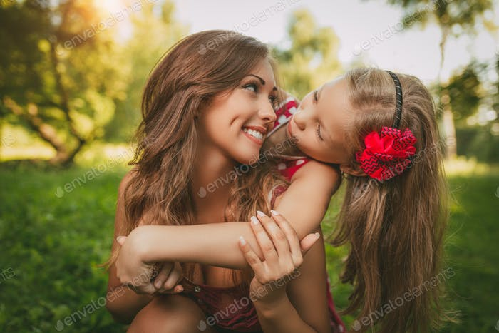 Cute Little Girl And Her Mom