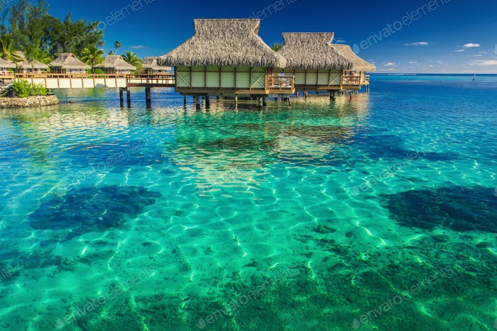 Villas in the lagoon with steps into shallow water with coral