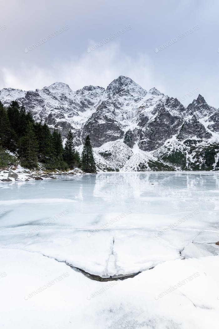 Morskie Oko Lake Covered in Ice at Winter in Tatra Mountains Poland