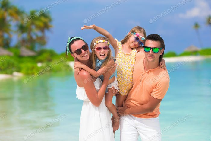 Happy beautiful family vacation on white beach