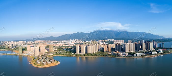 beautiful jiujiang cityscape at dusk, aerial view of mountains-water city, China