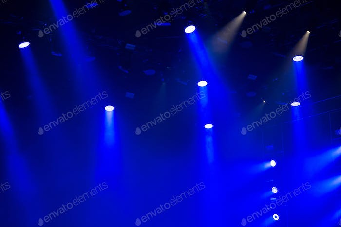 Stage lights glowing in the dark