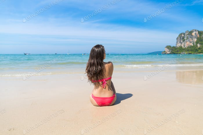 Attractive Young Caucasian Woman In Swimsuit Sitting On Beach Back Rear View, Girl Blue Sea Water