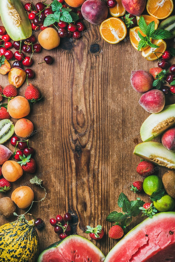 Summer fresh fruit variety over rustic wooden background