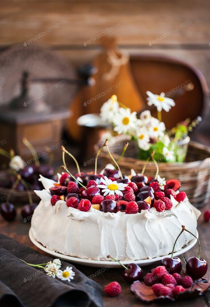 Delicious Pavlova meringue cake decorated with fresh raspberries