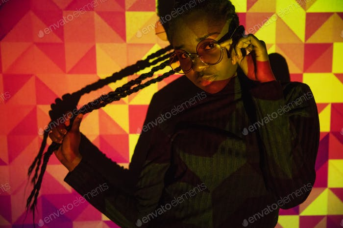 Creative colored pattern from projection light on beautiful women with dark skin