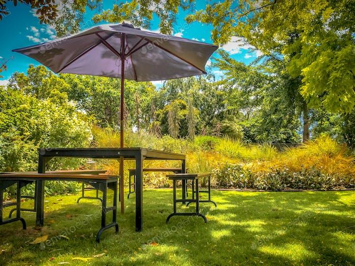 Garden furniture in shadow of backyard