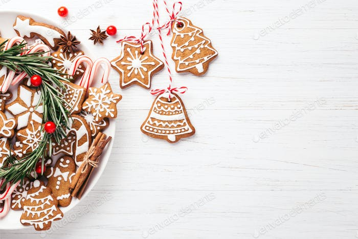 Plate with Christmas Gingerbread Coockies on Wooden Table.