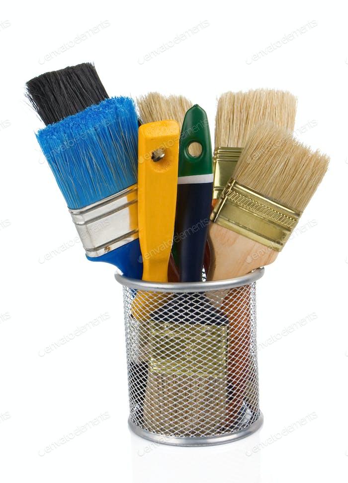 paint brush and basket holder on white