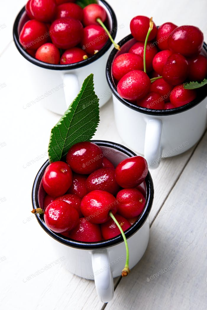 Cherry in enamel cup