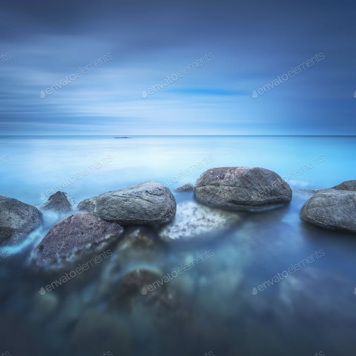 Rocks and soft sea, long exposure photography landscape.