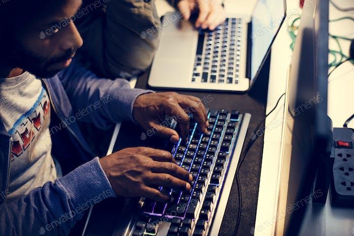 Hacker using keyboard typing phishing on the internet