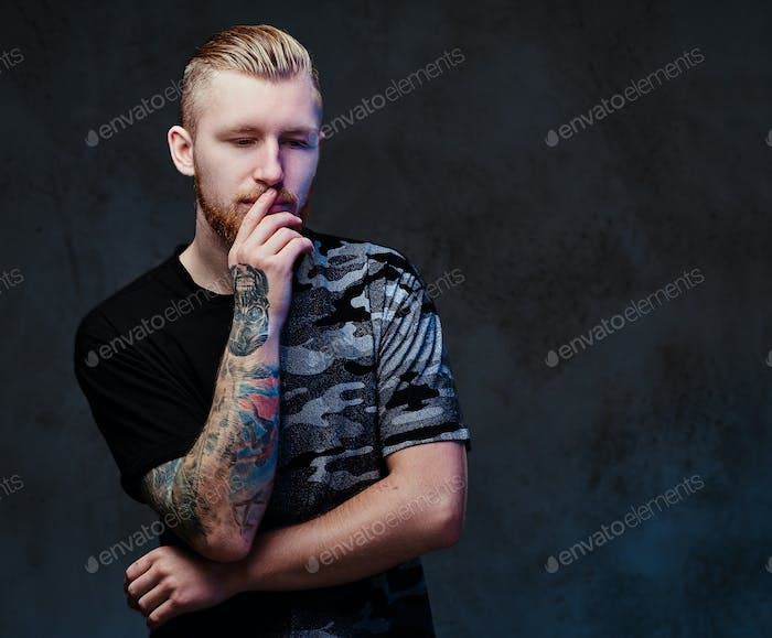 A man with tattoos on arms.
