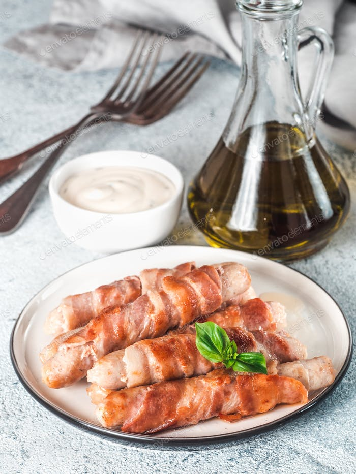 Sausages wrapped in bacon