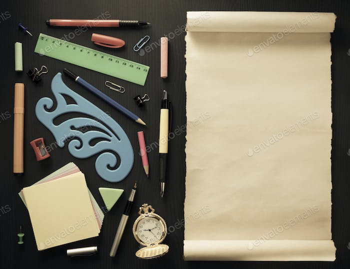 school supplies on black wood