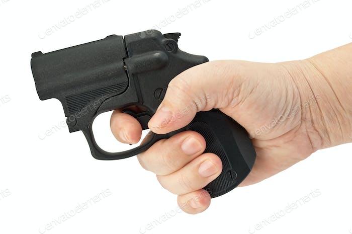 Traumatische Pistole in der Hand